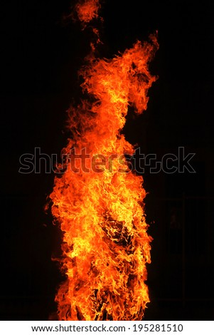 Big red yellow flames on black background - stock photo