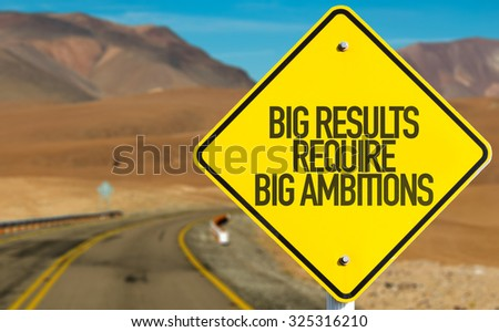 Big Results Require Big Ambitions sign on desert road - stock photo
