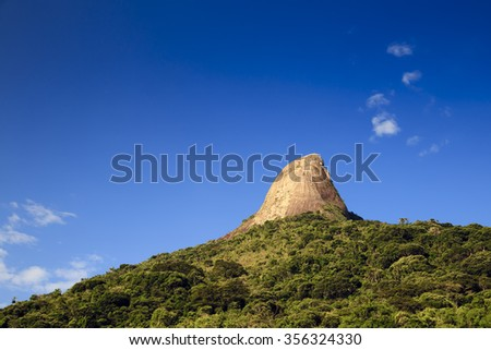 Big Rock at 'Saco Mamangua', the only fjord from Brazil. - stock photo