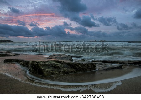 Big rock at the beach - stock photo