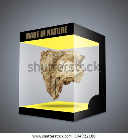 Big rock floating in transparent box and on gray gradient background - stock photo