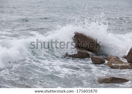 big rocks at beach with water