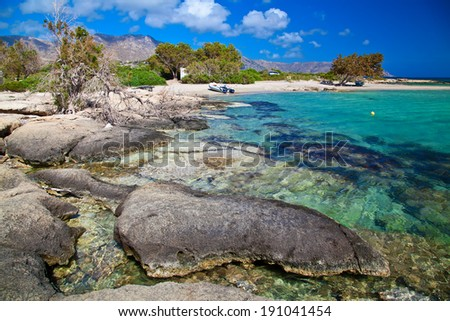 big rocks in water at the Elafonissi beach in Crete, Greece - stock photo