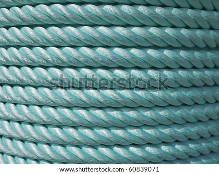 Big roll of green nylon cable rope