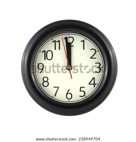 Big round wall clock shows almost twelve isolated on white close up - stock photo
