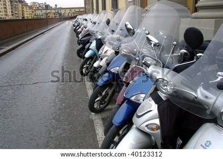 Big row of motorcycles on the street - stock photo