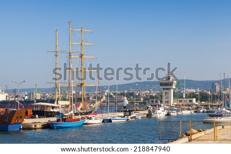 Big sailing ship and pleasure boats stand moored in Varna Port, Bulgaria - stock photo