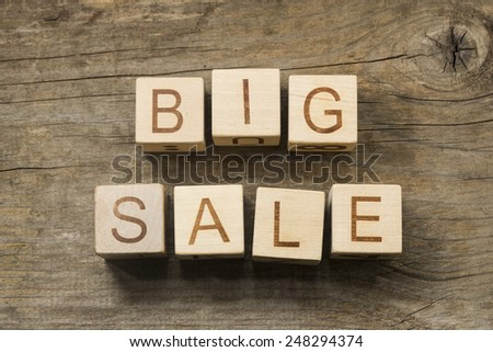 Big Sale text on a wooden background - stock photo