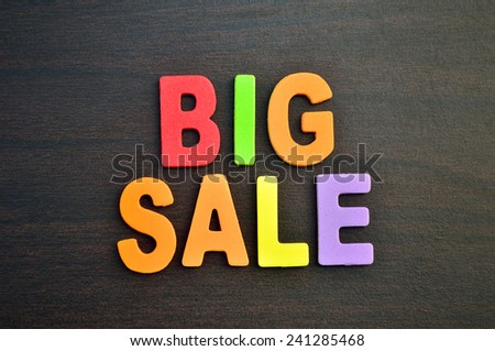 Big sale written with wooden letters on wooden background - stock photo
