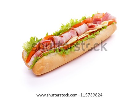 Big Sandwich on Long Baguette with Lettuce, Tomatoes, Cheese and Ham isolated on white background - stock photo