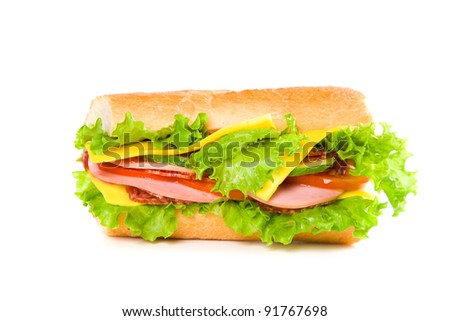 big sandwich with fresh vegetables isolated on white background