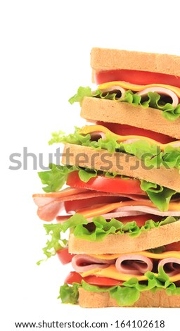 Big sandwich with fresh vegetables. Place for text. Whole background.