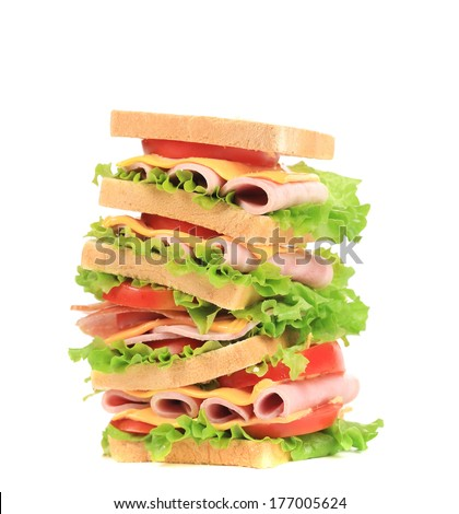 Big sandwich with ham and cheese. Isolated on a white background. - stock photo