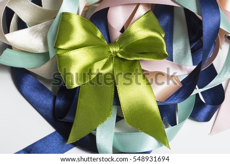 Big satin knot on colored satin tapes. Gift card layout design