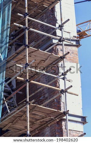 Big scaffolding on building at sunny day - stock photo