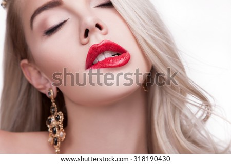 BIG sexy lips, mouth open, white teeth bit her lower lip, Seductive Lips RED.Women's full lips close-up, her mouth open and visible white teeth, biting his lower lip sexy.beauty.Beautiful blonde girl  - stock photo