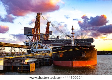 Big ship under loading coal in Port of Gdansk, Poland - stock photo