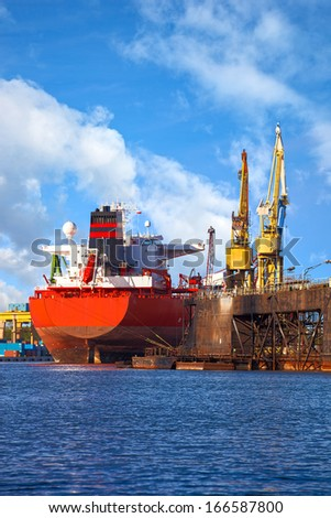 Big ship under repair in Gdansk Shipyard, Poland. - stock photo