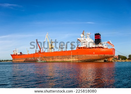 Big ship under repair in Gdansk Shipyard, Poland - stock photo