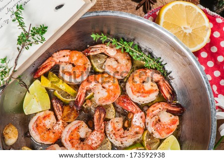 Big shrimps fried with lime, lemon and other spices - stock photo