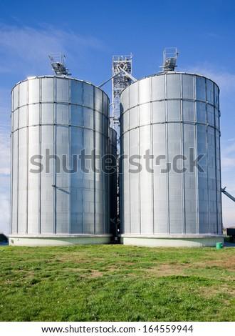 Big silos on large modern cow farm - stock photo