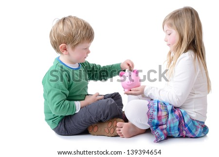 big sister teaching little brother to save for a rainy day isolated on white - stock photo