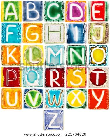 Big size colorful handmade ceramic alphabet isolated on white - stock photo