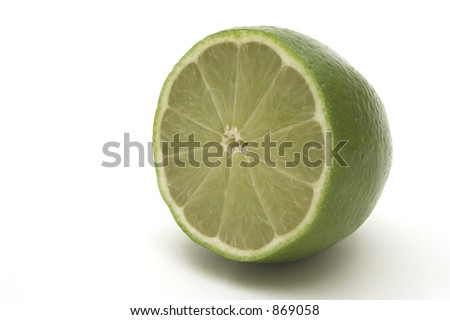 Big slice of green lime - stock photo