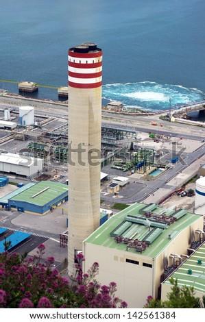big smokestack of factory near sea. Cierbana, Biscay, Basque Country, Spain - stock photo