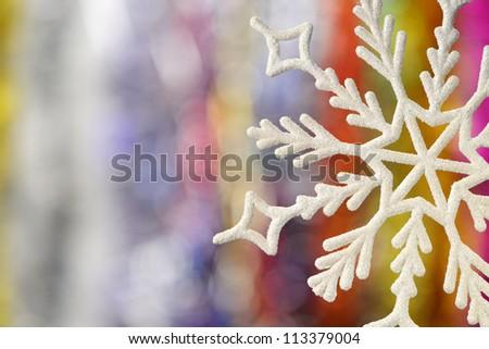 Big snowflake. Very blurred background - stock photo