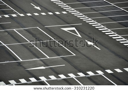 big space empty parking lot from above - stock photo
