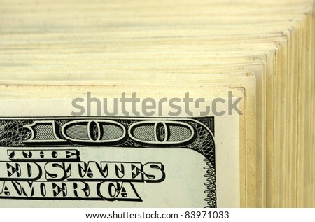 Big stack of $100 banknotes. Close-up view