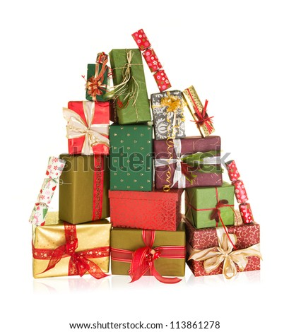 Big stack of christmas presents in the shape of a high mountain - stock photo