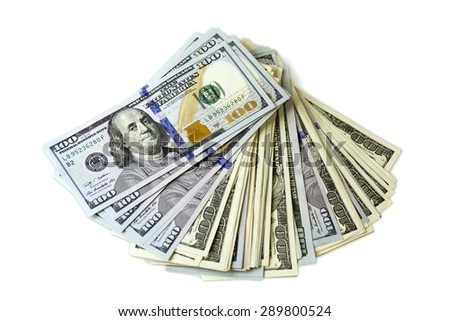 big stack of dollars spread out like fan on white background - stock photo