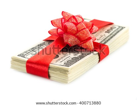 big stack of dollars with red bow isolated on white background