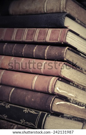 Big stack of old books with leather covers, vintage toned photo with filter effect
