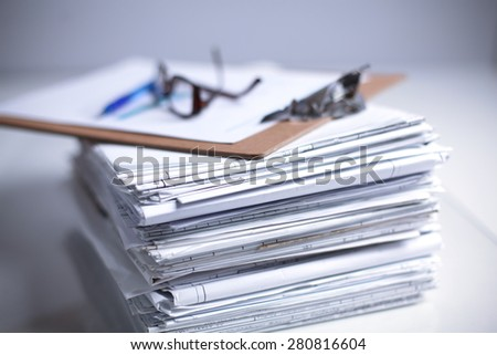 Big stack of papers ,documents on the desk - stock photo
