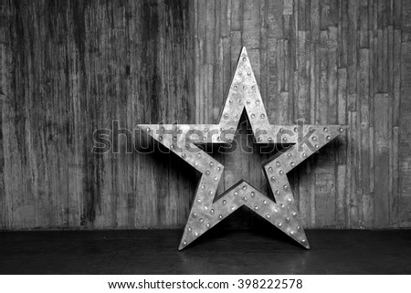 Big Star. Star object is on the floor against the backdrop of a concrete wall.