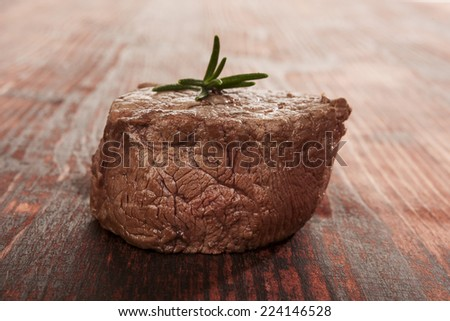 Big steak on wooden background. Culinary steak red meat eating. Beefsteak. - stock photo