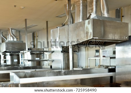 Big Steel Stainless Cooker Hood In Industrial Kitchen