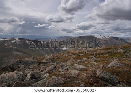 Big stones in Altai mountains under cloudy sky. Siberia Russia