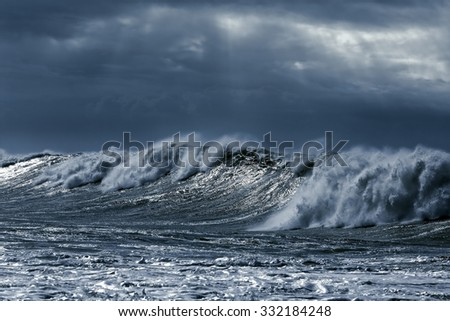 Big stormy waves approaching the portuguese coast. Toned blue - stock photo
