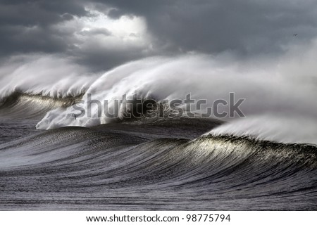 Big stormy waves crashing over Portuguese Coast - enhanced sky - stock photo
