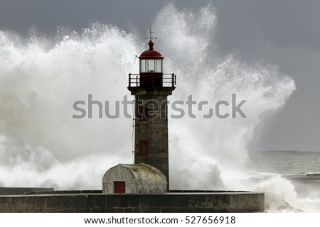 Big stormy waves over Douro river mouth old lighthouse, Porto, Portugal
