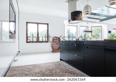 Big stylish kitchen in modern luxury residence - stock photo