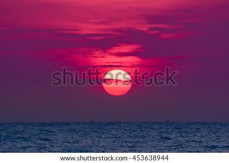 Big sun go down blue sea and purple color, as sunrise or sunset - stock photo