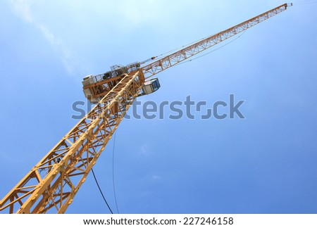 Big supper yellow construction crane for heavy lifting  - stock photo