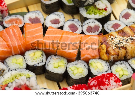 Big sushi set on a wooden background - stock photo