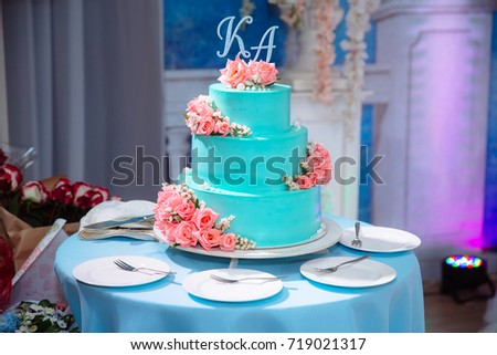 Big sweet multilevel wedding cake decorated with flowers. Concept of candy bar on party