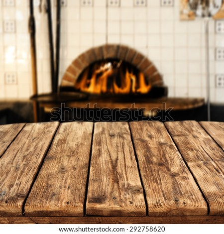 big table place and interior with fireplace  - stock photo